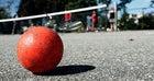 A well-used street hockey ball.