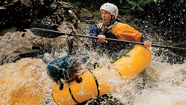 Running a class three rapid below Rafters Basin color image photography outdoors day one person mature adult mature men front view boating rafting inflatable raft packraft raft helmet transportation paddling rapids rivers speed adventure risk danger life jacket life preserver outdoor pursuit leisure activity fun motion action water splashes rock color image photography outdoors day one person mature adult mature men front view boating rafting inflatable raft packraft raft helmet transportation paddling rapids rivers speed adventure risk danger life jacket life preserver outdoor pursuit leisure activity fun motion action water splashes rock rafters basin class three rapid franklin river tasmania australia horizontal