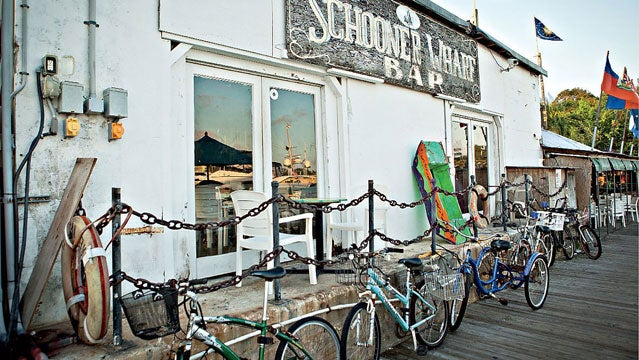 key west schooner wharf bar bicycles bike bikes structure building US USA america day daylight daytime exotic florida island keys no people nobody ocean outdoors outside tropical tropics quirky quaint eccentric south southern carefree whimiscal horizontal