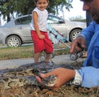 Ruben Ramirez shows the neighborhood kids his latest python.