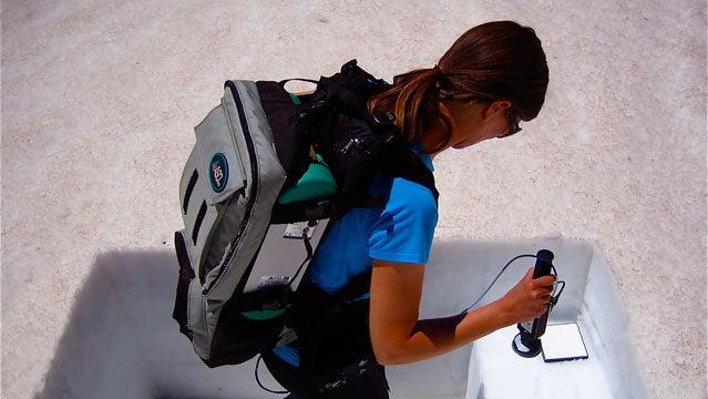 McKenzie Skiles wields her portable spectrometer.
