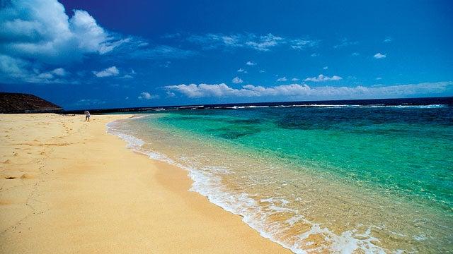 Hawaii Niihau Forbidden Island Nanina Beach North Shore person on beach best island island trips vacations travel