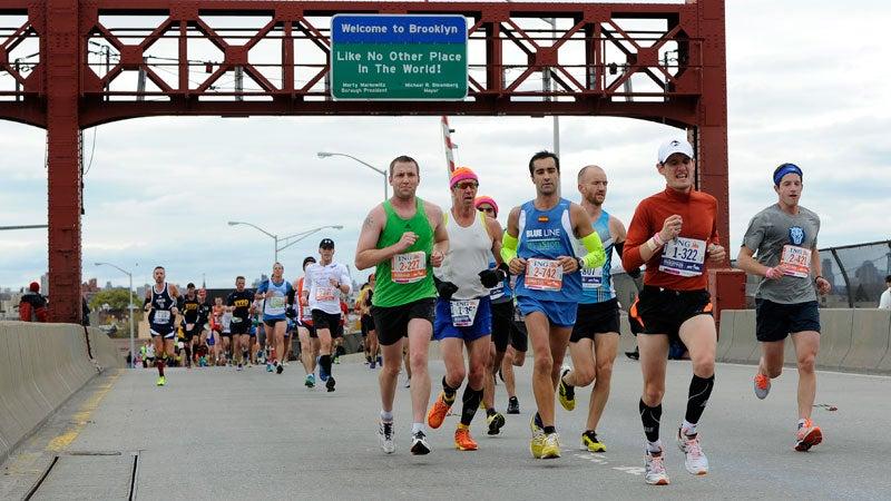 Runners cross over the Pulaski Bridge into the Queens borough of New York during the New York City Marathon on Sunday, Nov. 3, 2013.