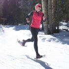 The author approaching the finish of a 10K snowshoe race.
