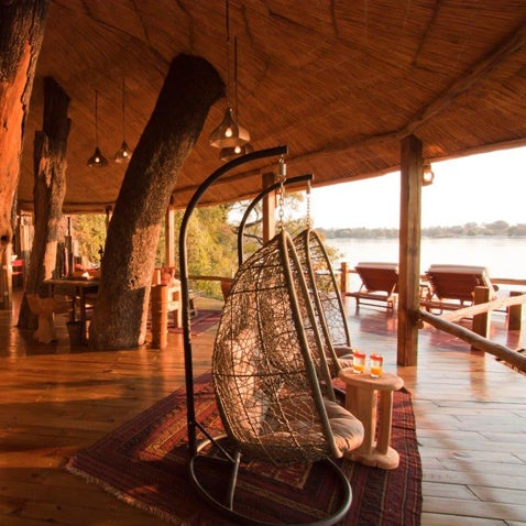 Floating over the Zambezi River in Zambia, built around four ebony trees, and tucked into a basalt riverbank, this tree house exceeds expectations. Read more.