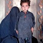 Outside magazine May 2014 child disabled internally Kabul IDP fled Taliban homes camp