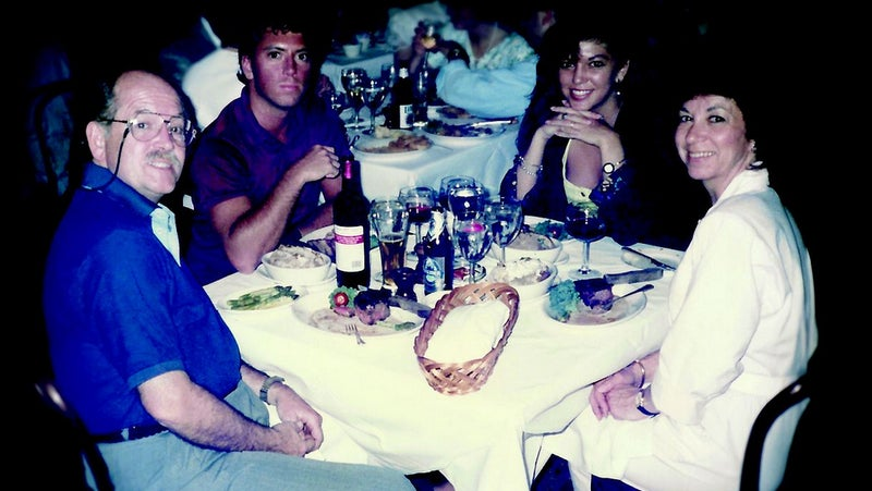 Chris, Walt, Billie, and Carine at dinner after his graduation from Emory University in May 1990.