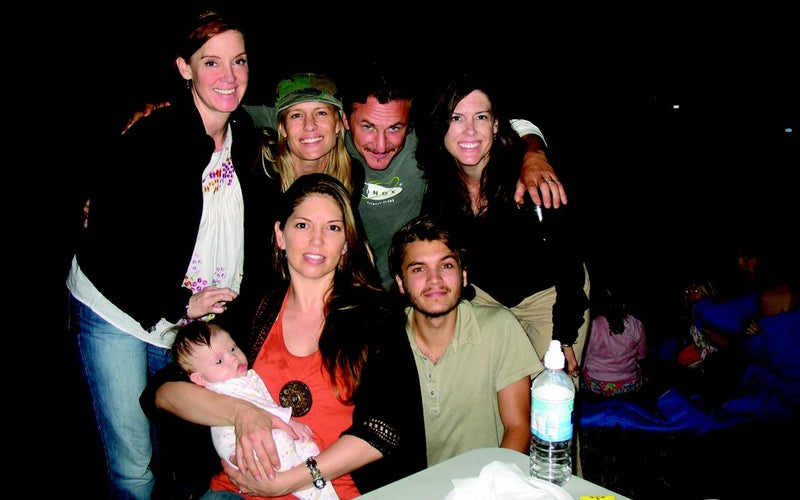 (Clockwise from bottom left) Carine McCandless and her daughter Christiana, Shelly McCandless, Robin Wright, Sean Penn, Shawna McCandless, and Emile Hirsch on the South Dakota movie set of Into the Wild in the summer of 2006.