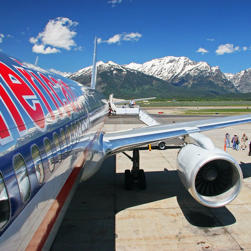 alpine wyoming wy airport airplane wide angle 17mm 17-85mm 17-85 american airlines aa aal boeing boeing 757 757 boeing 757-200 757-200 jet jetliner aircraft airliner airline tourism travel travel photography jackson hole kjac jac jackson hole airport mountains summer grand tetons grand teton national park grand teton gtnp tarmac deplaning disembark disembarking canon eos 20d canon 20d eos 20d 20d