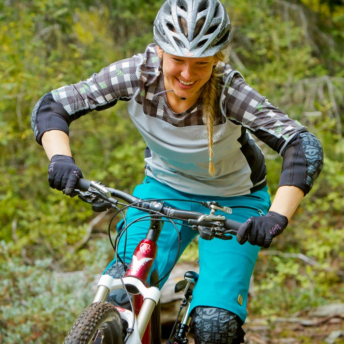 When you're climbing or pedaling a smooth trail, you often want to stay in the saddle. But when you're riding technical terrain, especially descending, stand on your pedals with a slight bend in your knees, waist, and elbows. It's an athletic stance that helps absorb bumps in the trail. And it creates a frame to prevent you from getting pushed around in the process.