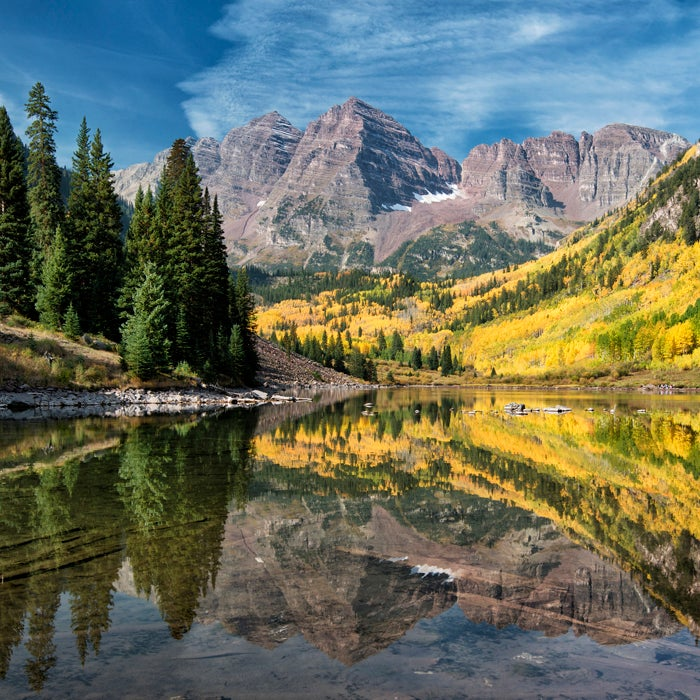 """The Maroon Bells boast some of the most scenic hiking in the country, and many people complete the route safely every year—but it's not to be taken for granted. The 12-mile round-trip hike to the summit of the South Ridge is fraught with loose rock fields, steep paths, gullies, and plenty of places to get lost. Oh yeah, and there's the mercurial weather. The trail is relatively easy until you get above 11,000 feet on its east slope. From there, the climb gets rougher the higher you get. The Maroon Bells got their deadly reputation after eight people died in five separate incidents, earning them the nickname """"The Deadly Bells."""" A U.S. Forest Service sign on the trail sums it up: """"The beautiful Maroon Bells … have claimed many lives in the past few years. They are not extreme technical climbs, but they are unbelievably deceptive. The rock is down sloping, rotten, loose, and unstable. It kills without warning. The snowfields are treacherous, poorly consolidated, and no place for a novice climber. … Expert climbers who did not know the proper routes have died on these peaks."""""""