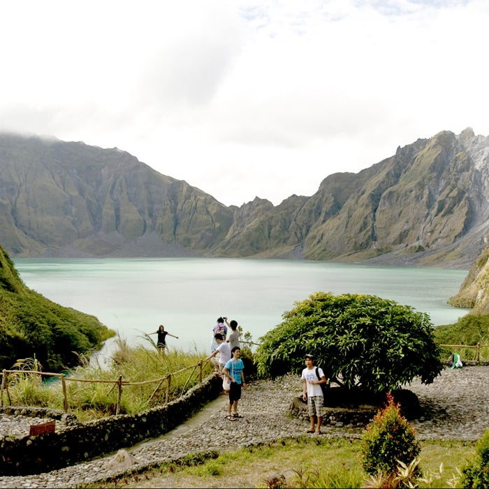People come from all over the world to hike up to Mount Pinatubo's crater lake. But after 400 years of dormancy, this volcano suddenly erupted in 1991, killing 800 people. It erupted again in 1992, that time claiming 72 victims. The Pinatubo eruption was the second largest of the century, ejecting at least 15 million tons of sulfur dioxide gas, which lowered temperatures on a global scale, temporarily accelerated depletion of the ozone layer, and brought lahars (showers of volcanic debris) raining down. If you ignore the volcano's tendency to blow up suddenly, the hike itself is relatively easy and takes anywhere from 50 minutes to two hours. If you take a dip in the crater lake, beware of floating into the middle, where there are strong currents.