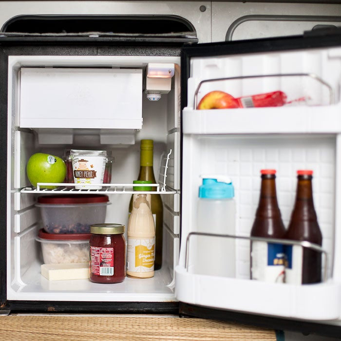 Pro tip: Store a quart-size Ziploc full of frozen water in the back of the freezer to make your fridge stay colder and conserve charge.