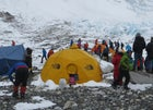 Guide Aaron Mainer holds back Tashi Sherpa (left, dark blue jacket) at Everest's Camp 2 during the scrum.