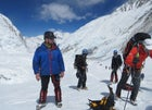 Ueli Steck (right, red jacket) approaches Everest's Lhotse Face, before the conflict at Camp 2 erupted.