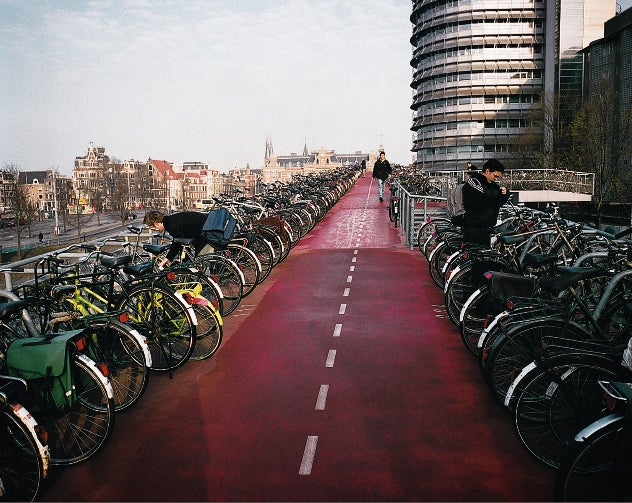 bicycling green energy green revolution sea level sustainability dutch florence williams holland kyoto protocol outside magazine outside online rising seas queen trix netherlands carbon dioxide zandmotor