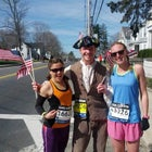 Runners Samantha Ryans and Whitney Dreier with Tom the Patriot.