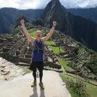 A runner celebrates at Machu Picchu.