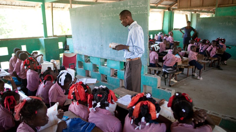 Students in adjacent classrooms at the Church of God of Savanne Tapion school.