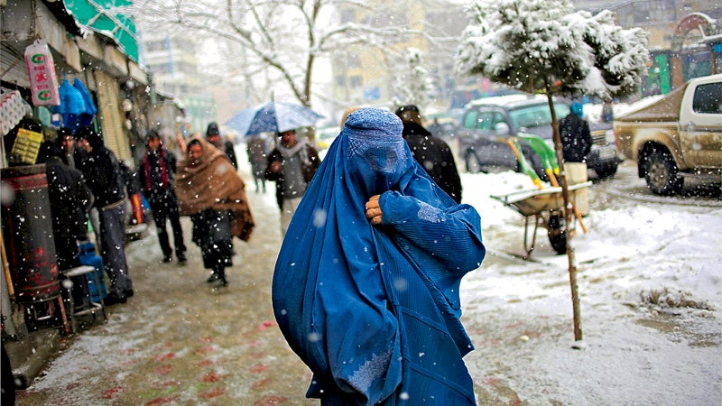 Outside May magazine 2014 Kabul Afghanistan woman walk snow covered