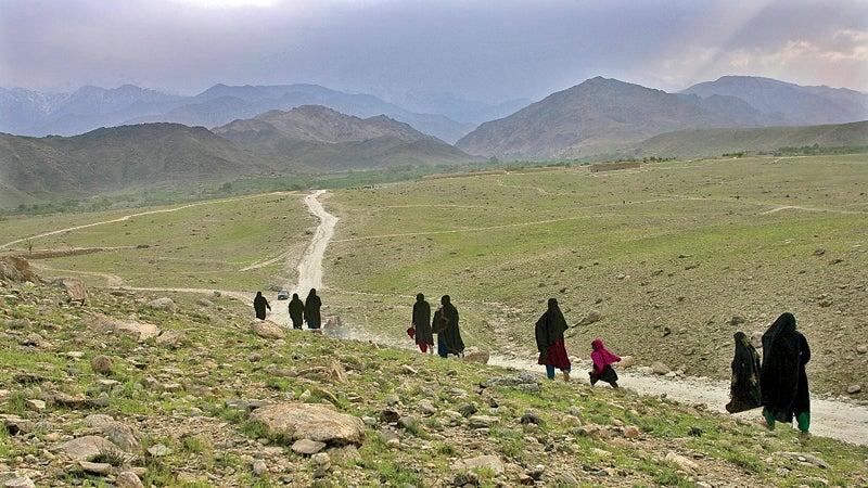 Outside magazine May 2014 women walk Acin Nangrahar Province Afghanistan tribal area