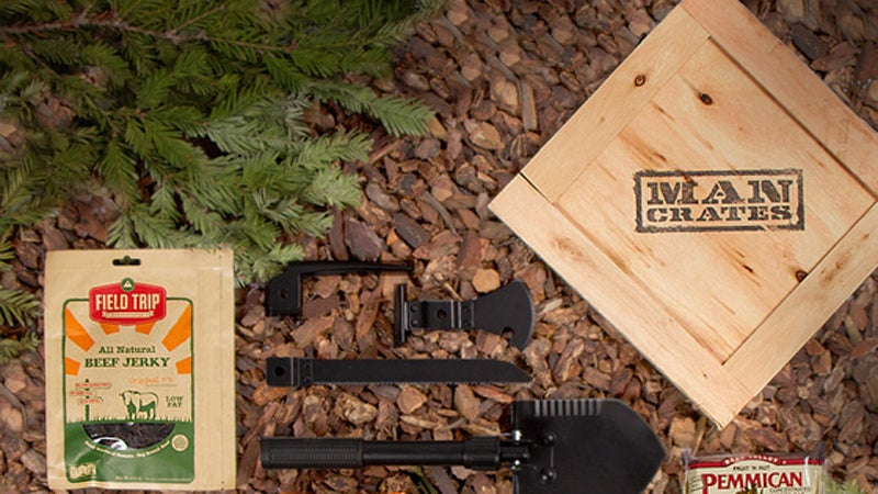 OutsideOnline survival crate Mancrates outdoor $99 wooden crate trunk shovel ice pick saw paracord knife blanket glow sticks cooking pot stove meal bar beef jerky crowbar large