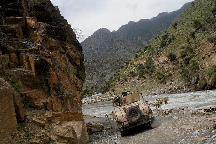 A humvee heads up the Kunar Riv