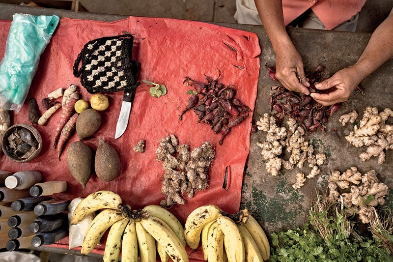 A woman sells natural medicines and food in a market in Cotamana.