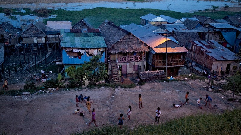 Kids play soccer in the slums of Iquitos, Peru.