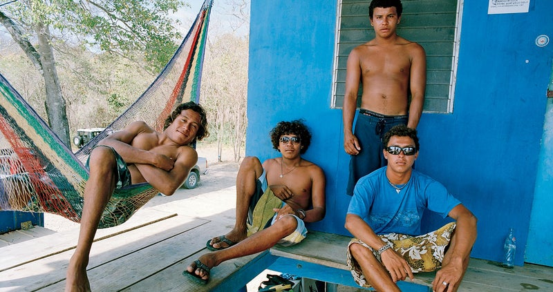 Surfers Samir Guillermo Duarte, Enrique Cascante, Mancel Cascante, and Oswaldo Bonilla at Playa Madera