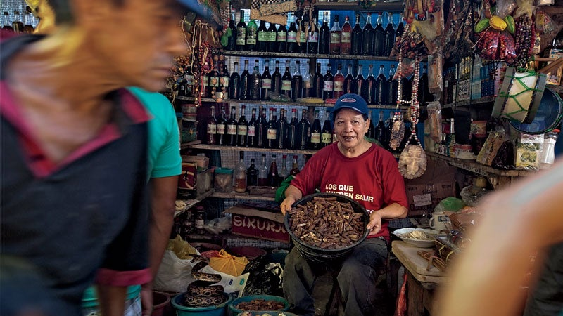A vendor of chuchuhuasi bark in Witches Alley.