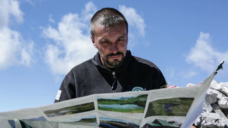 Kenan Muftić, Via Dinarica's project manager during the mapping stage of the route last year, ponders the next move in Bosnia and Herzegovina's Sutjeska National Park on the trail's virgin run.