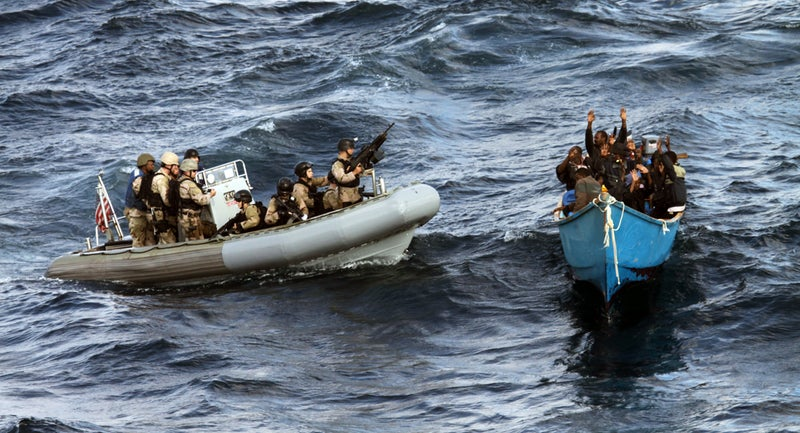 U.S. forces approach a suspected pirate vessel in the Gulf of Aden in December 2011.