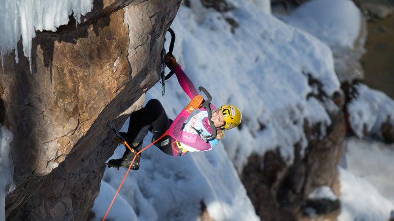 Women's overall winner Angelika Rainer takes a break on the wall.