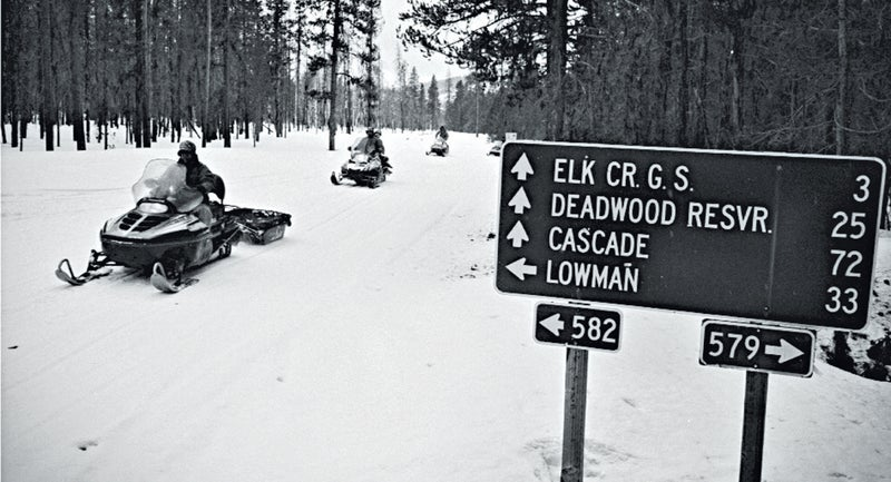 Tom Carter, co-owner of Deadwood Outfitters, pulls a gear sled during a wolf hunt in the Boise National Forest.