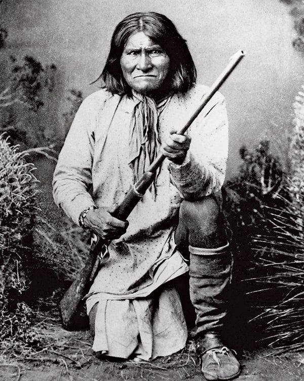 Chiricahua Apaches Clothing Cultural and ethnic dress Full-length portraits Full-length studio portraits Geronimo Holding Males People Portraits Prominent persons Rifle Studio portraits Traditional dress