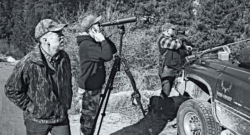 Tom Carter, left, T.J. Carter, center, and Elijah Coley, right, zeroing rifles in the Boise National Forest during a wolf hunt.