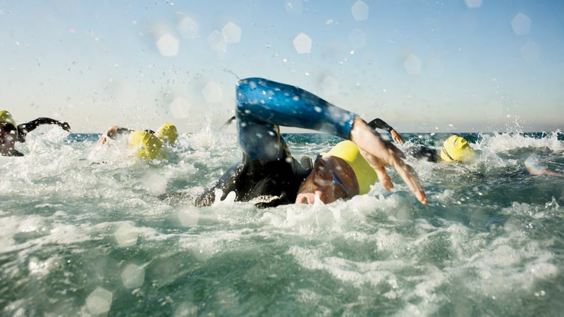 1 and Group 30s adult Adults Athlete Challenge Competition Endurance Fortitude Head and shoulders Intensity Males Marine scenes Men Mid-adult Mid-adult man Ocean Outdoors People Race Sports Sports event Swimmer Swimming Swimming competition Triathlete Triathlon Water Whites