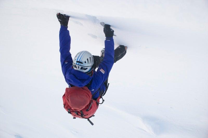 A climber attacks the stark white walls of Scotland's Cairngorms range.