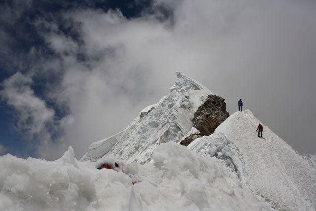 Summiting climbers