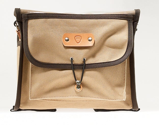 Acorn's canvas-and-leather Boxy Rando Bag ($209), a classic randonneuring design, sits on a small front rack, is easily removed for carrying with an optional strap ($11), and will keep your stuff dry in all but the soppingest downpours.
