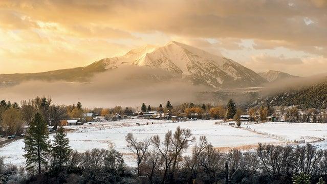 Colorado Mountains breaking storm carbondale clouds mount sopris snow sunrise outsize magazine best towns 2013 carbondale colorado