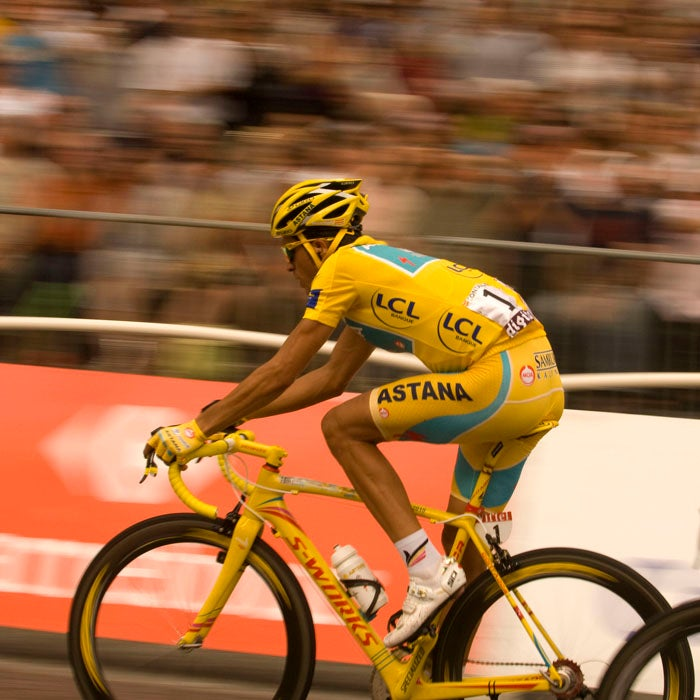 Contador cruises down the Champs Elysées toward what seemed to be his third Tour de France victory in 2010. But weeks later, his win came into question when traces of clenbuterol, a banned substance, were found in his body. He would eventually be stripped of his third Tour title.