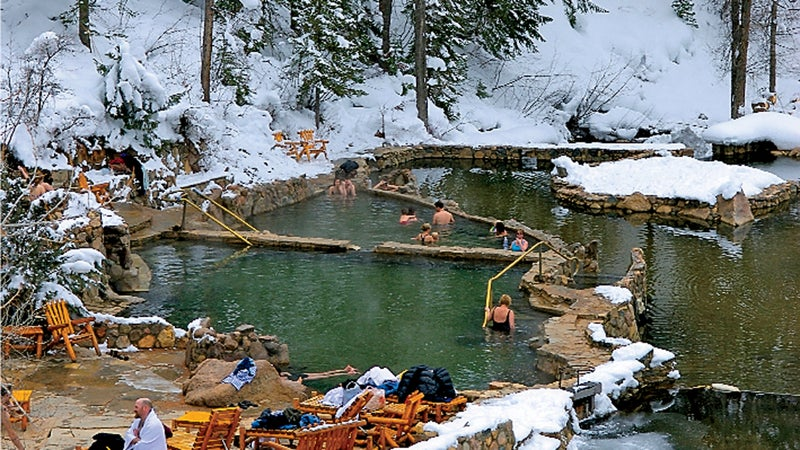 bathing Colorado color image Creek day Forest hot springs hot water Lifestyle Medium Group of People mountain OutdoorCollection outdoors pool Relaxing snow Soaking spa Steamboat Springs Strawberry Park Strawberry Ranch Hot Springs sulfur springs USA Vertical water winter