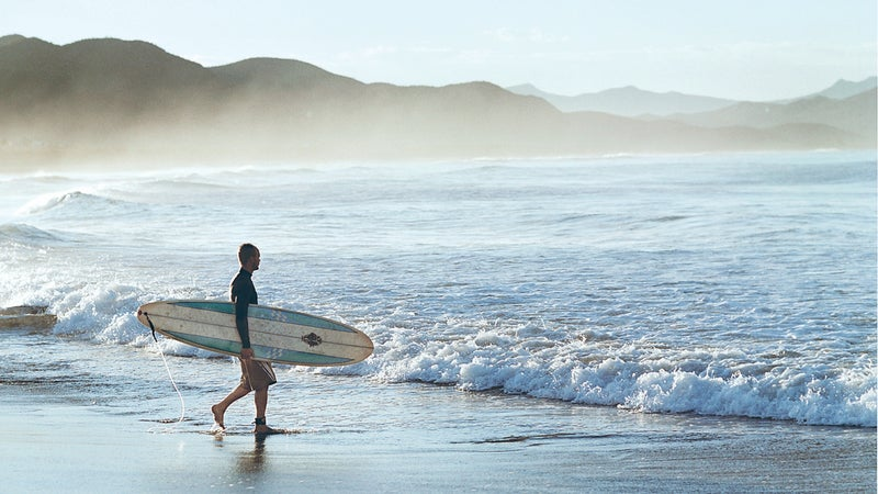 1 Person Background Baja California Beach Color Day Figure Full Body Shot Leisure Lifestyle Male Man Mexico Mist Noe DeWitt Ocean Sand Sea Shore Splash Standing Surf Board Surfboard Surfer Surfing Travel Vertical Water Waves Whitewash